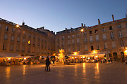 La Place du Parlement - the main square in the old city centre in Bordeaux - at night. Lots of restaurants, outside seating and people