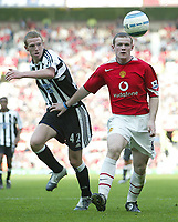 Fotball<br /> England 2004/2005<br /> Foto: SBI/Digitalsport<br /> NORWAY ONLY<br /> <br /> Manchester United v Newcastle United<br /> FA Barclays Premiership<br /> Old Trafford<br /> 24/04/2005<br /> <br /> Manchester's Wayne Rooney and Newcastle's Peter Ramage