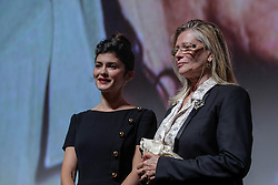 (R-L) ANNIE MILLER; widow of the late director Claude Mille and actress AUDREY TAUTOU walk on stage during introductions to 'Therese Desqueyroux' at the 2012 Toronto International Film Festival, September 11th, 2012. Photo by David Tabor/i-Images.