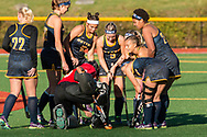Pleasantville, New York - Pace University field hockey players huddle together before a Northeast-10 Conference playoff game on Oct. 31, 2017.
