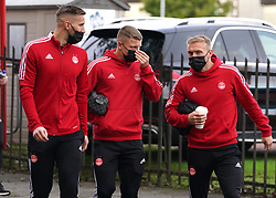 Aberdeen's Dylan McGeouch (right) with team-mates as they arrive to the ground ahead of the cinch Premiership match at Pittodrie Stadium, Aberdeen. Picture date: Sunday October 3, 2021.