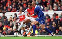 Thierry Henry (Arsenal) Matt Elliott (Leicester). Arsenal 6:1 Leicester City, FA Carling Premiership, 26/12/2000. Credit Colorsport / Stuart MacFarlane.