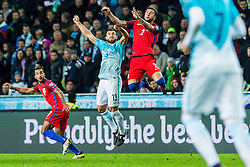 Bojan Jokic of Slovenia and Danny Rose of England and Theo Walcott of England during football match between National teams of Slovenia and England in Round #3 of FIFA World Cup Russia 2018 qualifications in Group F, on October 11, 2016 in SRC Stozice, Ljubljana, Slovenia. Photo by Grega Valancic / Sportida