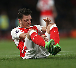05 April 2017 London : Premier League Football; Arsenal v West Ham United :<br /> Mesut Ozil sits it out after losing the ball.<br /> Photo: Mark Leech