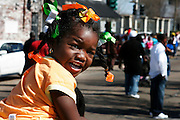 February 28th 2006. New Orleans, Louisiana. United States..A little girl seated on her bother's shoulders waits for the Zulu Mardi Gras Walking Parade on Orleans Avenue.