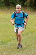 New Paltz, New York - Eric Weis runs through the Mohonk Preserve during the Shawangunk Ridge Trail Run/Hike 20-mile race  on Sept. 20, 2014.