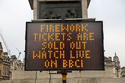 "© Licensed to London News Pictures. 30/12/2018. London, UK. A sign saying ""Firework tickets are sold out watch live on BBC1"" in Trafalgar Square, ahead of New Year celebrations. Photo credit: Dinendra Haria/LNP"