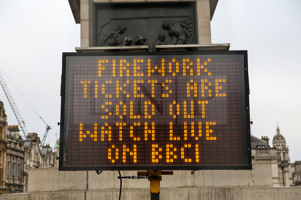 """© Licensed to London News Pictures. 30/12/2018. London, UK. A sign saying """"Firework tickets are sold out watch live on BBC1"""" in Trafalgar Square, ahead of New Year celebrations. Photo credit: Dinendra Haria/LNP"""