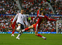 Photo: Andrew Unwin.<br />England v Macedonia. UEFA European Championships 2008 Qualifying. 07/10/2006.<br />England's Wayne Rooney (L) competes with Macedonia's Veliche Sumulikoski (R).