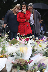 March 18, 2019 - Christchurch, New Zealand - Residents pay their respects outside the Al Noor mosque. At least 50 people were killed and 36 injured in mass shootings at two mosques in the New Zealand city of Christchurch on Friday. A 28-year-old Australian born man has been charged with murder. (Credit Image: © Sanka Vidanagama/NurPhoto via ZUMA Press)