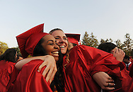 Ashley Greenridge (l) and Stephanie Luchene embrace after graduating from Wellesley High School, June 3, 2016.<br /> Wicked Local staff photo / Kate Flock