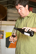 Philippe Gard Domaine Coume del Mas. Banyuls-sur-Mer. Roussillon. Owner winemaker. Tasting wine. France. Europe. Bottle. Wine glass.