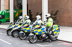 Metropolitan Traffic Police Officers prepare for the start of the planned demonstration by London Black Cab drivers as they protest over the refusal to place a Black Cab taxi rank outside the entrance to The Shard. May 2013 London