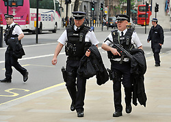© under license to London News Pictures. LONDON, UK  17/05/2011. Armed officers on Whitehall. Police carry out security checks in Whitehall, Central London today (17 May 2011). Please see special instructions for usage rates. Photo credit should read Stephen Simpson/LNP.