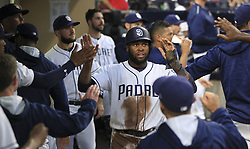 June 28, 2017 - San Diego, CA, USA - The San Diego Padres' Manuel Margot is congratulated in the dugout after he scored on a single hit by Wil Myers in the third inning against the Atlanta Braves at Petco Park in San Diego on Wednesday, June 28, 2017. (Credit Image: © Hayne Palmour Iv/TNS via ZUMA Wire)