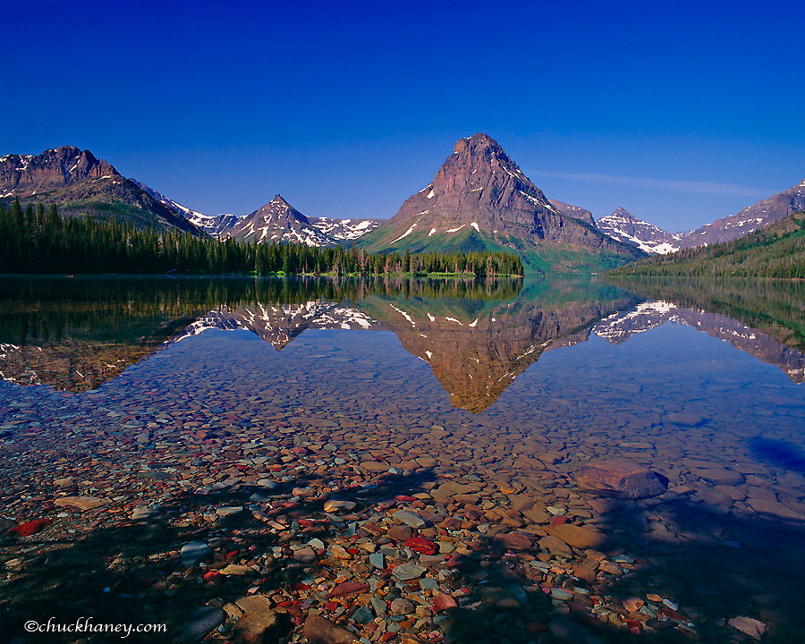 Two Medicine Lake on a calm morning in Glacier National Park in Montana
