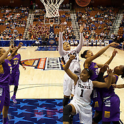 Tanaya Atkinson, (center), Temple, rebounds during the Temple Vs East Carolina Quarterfinal Basketball game during the American Athletics Conference Women's College Basketball Championships 2015 at Mohegan Sun Arena, Uncasville, Connecticut, USA. 7th March 2015. Photo Tim Clayton
