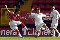 Photo: Olly Greenwood.<br />Charlton Athletic v New Zealand. Pre Season Friendly. 05/08/2006. Charltons Simon Walton shoots past New Zealands Chris James