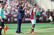 Slaven Bilic, West Ham United manager giving instructions to Gokhan Tore of West Ham United from the touch line. Premier league match, West Ham Utd v AFC Bournemouth at the London Stadium, Queen Elizabeth Olympic Park in London on Sunday 21st August 2016.<br /> pic by John Patrick Fletcher, Andrew Orchard sports photography.