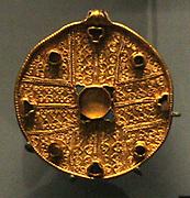 Jewelled disc pendants and bracteate, gold, glass and garnet. 550-650, Faversham, Kent.