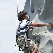 Maddox Laughlin, 10, climbs on a ride Sunday August 17, 2014 during Ribfest Battleship Park in Wilmington, N.C. (Jason A. Frizzelle)