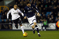 Harry Donovan of Millwall (R) in action with Leon Clarke of Sheffield United (L) chasing. EFL Skybet championship match, Millwall v Sheffield Utd at The Den in London on Saturday 2nd December 2017.<br /> pic by Steffan Bowen, Andrew Orchard sports photography.