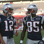 New England quarterback Tom Brady (12) and wide receiver Chad Ochocinco (85) talk prior to an NFL football game between the New England Patriots and the Tampa Bay Buccaneers at Raymond James Stadium on Thursday, August 18, 2011 in Tampa, Florida.   (Photo/Alex Menendez)