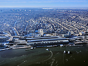 Nederland, Noord-Holland, Amsterdam, 13-02-2021; Winter in Amsterdam, zicht op IJ met potveren en Centraal Station en binnenstad.<br /> Winter in Amsterdam, view of the river IJ and Central Station and city center.<br /> <br /> luchtfoto (toeslag op standaard tarieven);<br /> aerial photo (additional fee required)<br /> copyright © 2021 foto/photo Siebe Swart