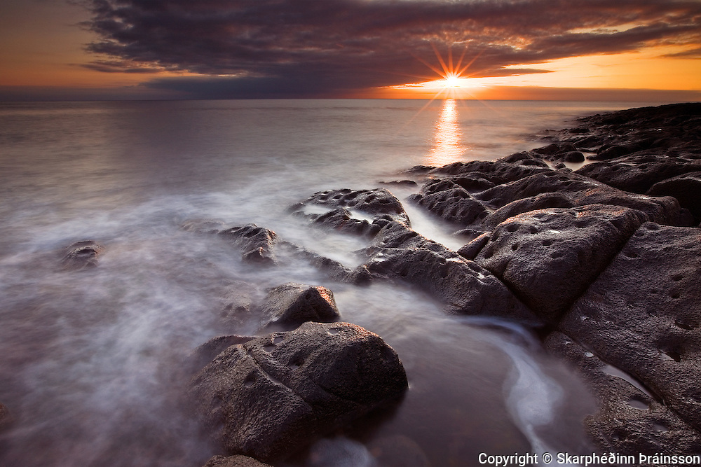 Sunset at rocky beach<br /> West Iceland