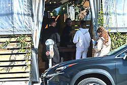 EXCLUSIVE: Ashley Tisdale lines up to pick up take out food as the restaurant is closed to dining in due to the Coronavirus. 18 Mar 2020 Pictured: Ashley Tisdale. Photo credit: P&P / MEGA TheMegaAgency.com +1 888 505 6342
