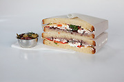 cheese sandwich with tomato and olive side dish