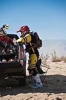 201x motorcycle rider Derek Duncan waits at race mile 58 for rider change, 2012 San Felipe Baja 250, San Felipe, Baja California, Mexico.