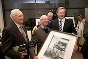 The 1950s Ireland in Pictures. From Lensmen Photographic Archive.A unique collection of photographs that captures the essence of life in 1950's Ireland was launched last night (Tuesday 6th November) by An Taoiseach, Mr Enda Kenny TD at the RHA Gallery, Ely Place, Dublin 2..Pictured at the event were;.Padraig MacBrian, Founder Director, Lensmen, .Andrew Farren, Founder Director, Lensmen, An Taoiseach, Mr Enda Kenny,.TD ..The 1950s Ireland in Pictures, which is published by O'Brien Press, contains 130 images from the Lensmen Photographic Archives. The stunning and thought-provoking images will bring back memories of the people, personalities and events that shaped the decade and offer a fascinating insight into the cultural and political events of that time..Lensmen, Ireland's premier photographers, was established in 1952 by Andrew Farren and Padraig MacBrian and this year celebrates 60 years in continuous business.  Lensmen Photographic Agency is the oldest leading press and social photographer in Ireland.  The Lensmen Collection - licensed to Irishphotoarchive.ie - comprises almost three million images documenting every aspect of life from the 1950s to to-day..The 1950s Ireland in pictures captures images from the world of entertainment and theatre; Olympic achievements and sporting events; horse-racing and show-jumping; politics and religion; industry and agriculture, and much more.  Christy Ring, Laurel and Hardy, Ronnie Delany, Tom Barry, Joseph Locke, Noel Purcell, Maeve Kyle, Leo Rowsome, Cyril Cusack, Siobhan McKenna, Vivien Leigh, Noel Coward and Michael MacLiammoir are among the well -known personalities in the book..The 1950's marked the last decade of 'old' Ireland when all communication was local.  It was prior to the introduction of television and the massive growth in international communications that ensued..A read through the 1950s Ireland in Pictures will capture the memories of those who lived through the decade, bring credibility to those who hear