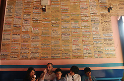The Pico family, (left to right), Maria Gabriella, Manuel, Manuel Enrique, Corrina and Carlos, eat a few of the many weird and wondrous flavors available at the Coromoto ice cream parlor in Merida, Venezuela.  The shop, infamous for it's wacky flavors like tuna, meat, smoked trout, spaghetti with cheese and viagra, has been in the Guinness book of World Recrords several times for having the most ice cream flavors in the world.  Tasting the ice cream before buying it is not allowed, so every customer is never sure what they will get.
