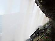 Behind the cascading water at Sapo Falls, near Canaima lagoon in Canaima National Park, Venezuela