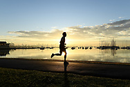 An early morning jogger on the foreshore of Williamstown as the sunrises across the bay over Melbourne on the 7th day the state wide COVID-19 lockdown that has been placed on the State of Victoria. (Photo by Michael Currie/Speed Media)