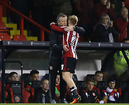Chris Wilder manager of Sheffield Utd greets Mark Duffy of Sheffield Utd as he substitutes him during the English League One match at Bramall Lane Stadium, Sheffield. Picture date: December 10th, 2016. Pic Simon Bellis/Sportimage