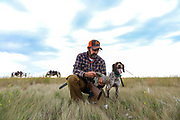 John Zeman,with his GSP Liza, admires a  Montana sharptailed grouse.