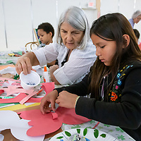 Khloe Chee, 8, works on a paper butterfly with help from Mirakhel Windsong from the McKinley Citizen's Recycling Council at the Rio West Mall's Kids Fest Tuesday afternoon.