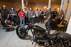 Custom builder Jimmie Lee Coen in the In Motion invitational bike show build to other builders and judges during the Lone Star Rally. Galveston, TX. USA. Friday November 3, 2017. Photography ©2017 Michael Lichter.