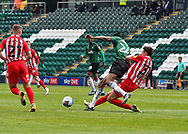 Sunderland Forward Ross Stewart (31) battles for the ball with Plymouth Argyle Defender Jerome Opoku (24)  during the EFL Sky Bet League 1 match between Plymouth Argyle and Sunderland at Home Park, Plymouth, England on 1 May 2021.