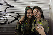 Two young Japanese women dressed as soldiers during the Halloween celebrations in Shibuya, Tokyo, Japan. Wednesday October 31st 2018 .  Halloween has grown massively popular  in Japan over the last few yers. Primarily an event for young adults who use it as a chance to dress up in inventive costumes and spend the night partying . In recent years the misbehaviour of some revellers has caused a heavier police presence on the street and  a push back from the Japanese society, and media  who see no need for nor benefits to this western cultural import.