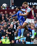 Nathan Baker of Aston Villa ® battles with David Davis of Birmingham city.  EFL Skybet championship match, Aston Villa v Birmingham city at Villa Park in Birmingham, The Midlands on Sunday 23rd April 2017.<br /> pic by Bradley Collyer, Andrew Orchard sports photography.