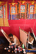 Artists paint Buddhist mandala paintings in Lhasa, Tibet.