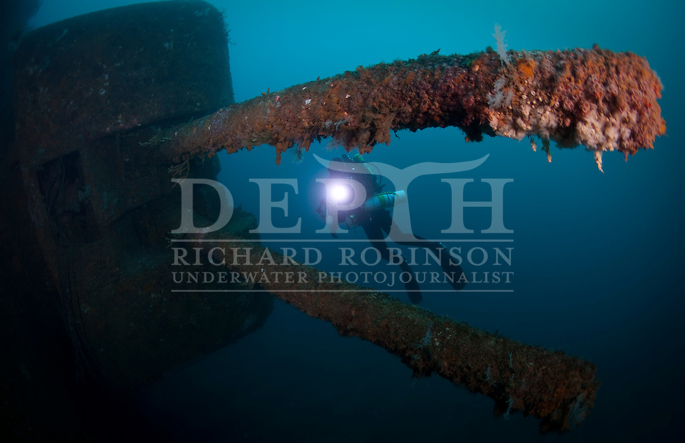 Underwater Photographer Ian Skipworth with the twin 4.5 inch (114 mm) guns on the Wreck of the HMNZS Waikato (F55) a Leander class Frigate, after being decommissioned by the Royal New Zealand Navy serves as an artificial diving reef off the coast of Tutukaka, Northland, New Zealand..Saturday 03 September 2011..Photograph Richard Robinson © 2011..Dive Number: 376.Dive Buddy: Ian Skipworth..Site: Wreck HMNZS Canterbury, Northland..Temperature: 15 Degrees Celsius..Rebreather: Inspiration Vision. Total Time On Unit: 162:57 hh:mm.Mix : 21.Maximum Depth: 30.4 meters..Bottom Time: 76 minutes..Bottom Time to Date: 23,166 minutes..Cumulative Time: 23,242 minutes.