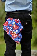 Groom with bandana in back pocket.
