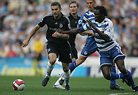 Photo: Lee Earle.<br /> Reading v Chelsea. The Barclays Premiership. 14/10/2006. Chelsea's Andriy Shevchenko (L) and Ibrahima Sonko battle.