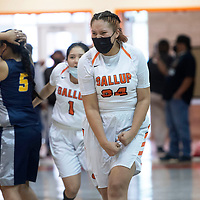 Gallup Bengal Jordan Joe (34) celebrates their win after she intercepts an inbounds pass during the final seconds of their New Mexico Class 4A girls basketball quarterfinal game against the Highland Hornets Tuesday in Gallup. The Bengals defeated the Hornets 53-51.