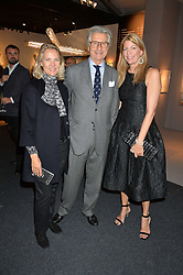 Left to right, CARLA BAMBERGER, ARNAUD BAMBERGER and COUNTESS COSIMA PAVONCELLI at the PAD London 2015 VIP evening held in the PAD Pavilion, Berkeley Square, London on 12th October 2015.