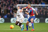 Bafetimbi Gomis of Swansea City and Brede Hangeland of Crystal Palace compete for the ball. Barclays Premier League match, Crystal Palace v Swansea city at Selhurst Park in London on Monday 28th December 2015.<br /> pic by John Patrick Fletcher, Andrew Orchard sports photography.